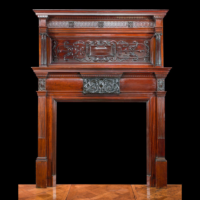 A tall Baroque style mahogany fireplace mantel