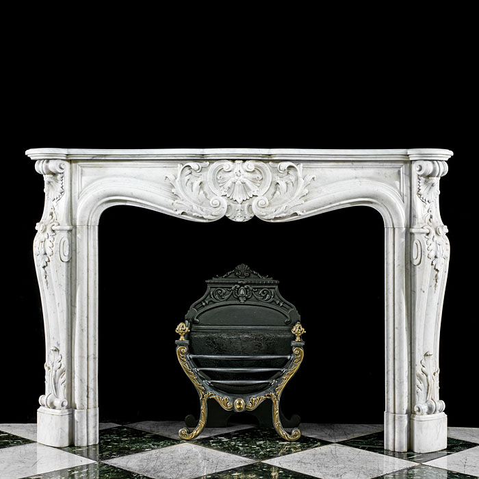 A Louis XV lightly veined Carrara Marble fireplace surround