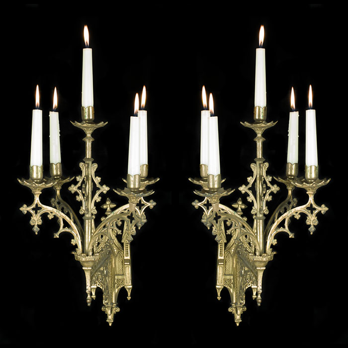 A pair of large Gothic Revival brass antique wall lights