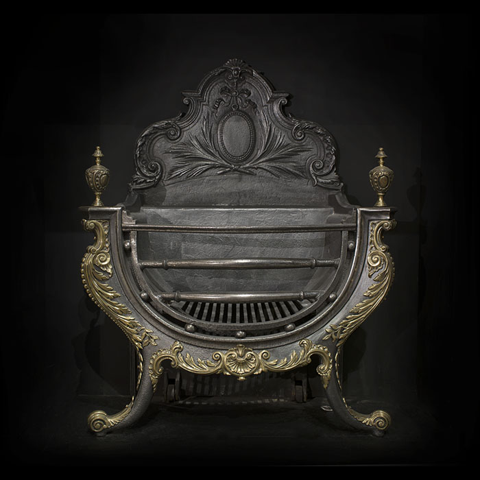 A large and ornate Rococo style cast iron Victorian fire grate