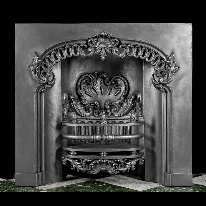 A large and impressive Rococo style early Victorian fireplace insert.