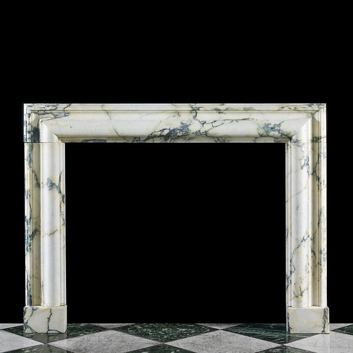 A 20th century Pavonazza Marble moulded fireplace bolection