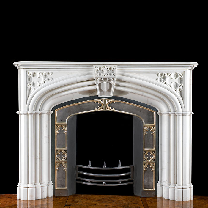 A Gothic Revival Statuary Marble Fireplace