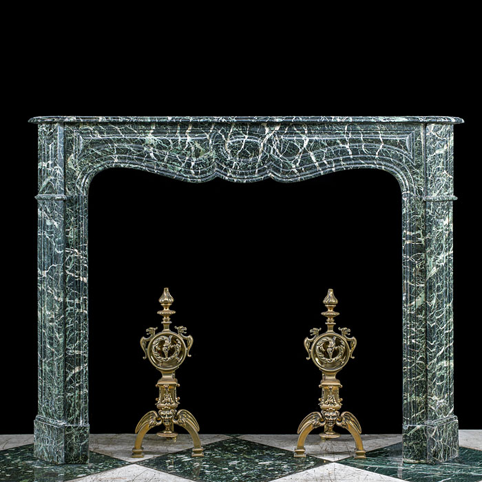 A Louis XVI style Tinos Green Marble Pompadour style fireplace mantel