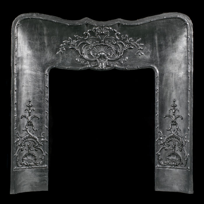 A late 19th century cast iron Louis XVI style fireplace insert