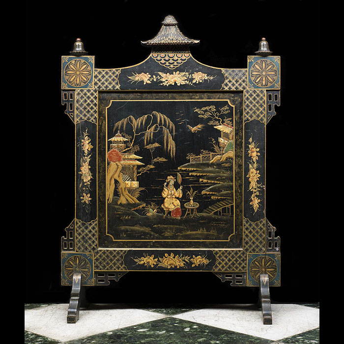 A Chinoiserie styled Edwardian lacquered fire screen