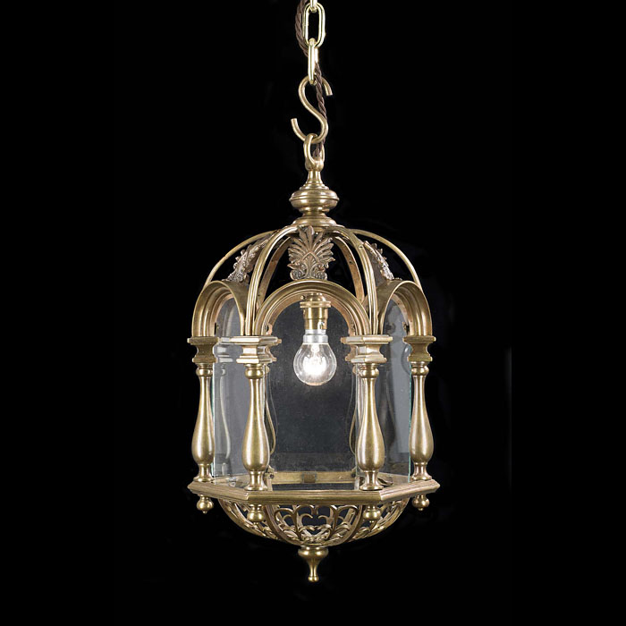 A pagoda style antique brass Edwardian hall lantern