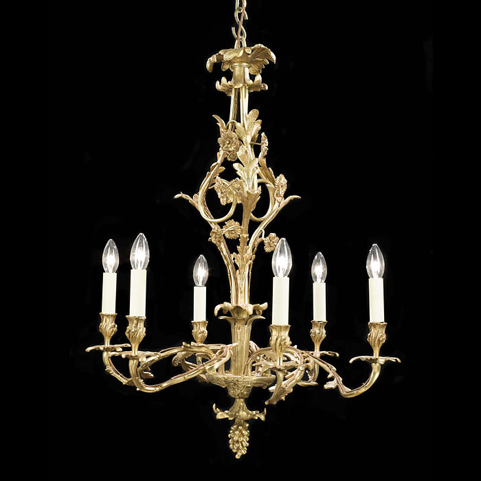 A Six Light Brass Antique French Chandelier