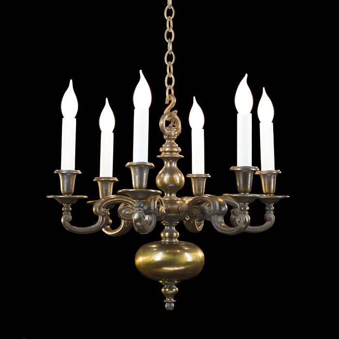A pair of Baroque style brass chandeliers
