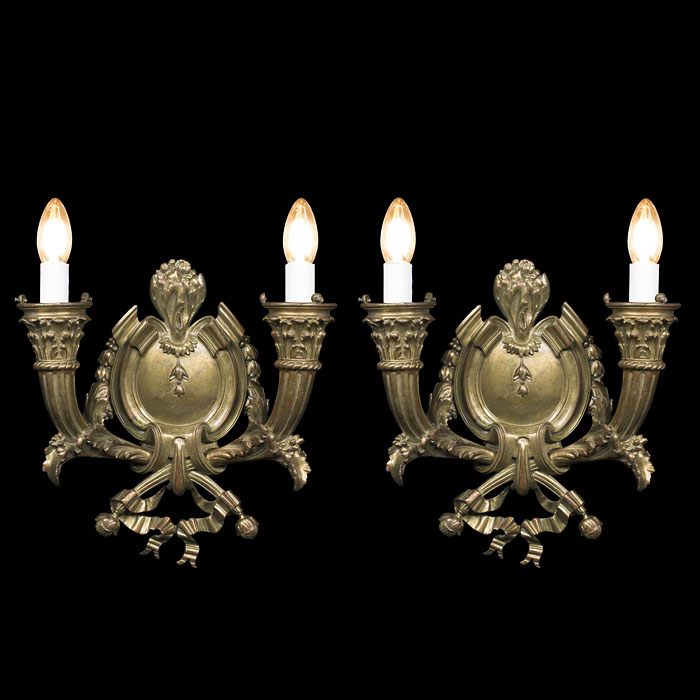 A pair of Regency style ormolu wall lights
