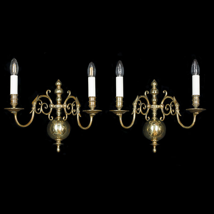 A pair of Baroque style brass wall lights