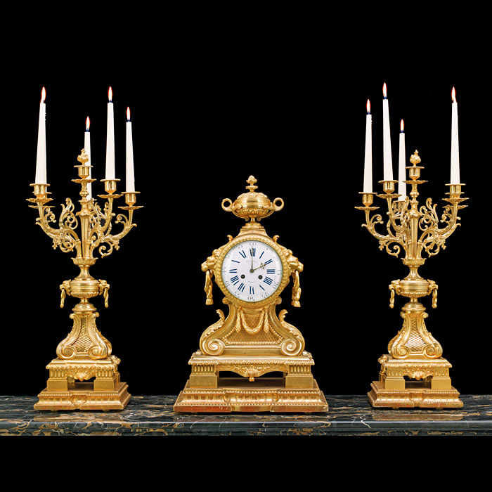 A Grand Gilt Bronze Antique Clock Garniture