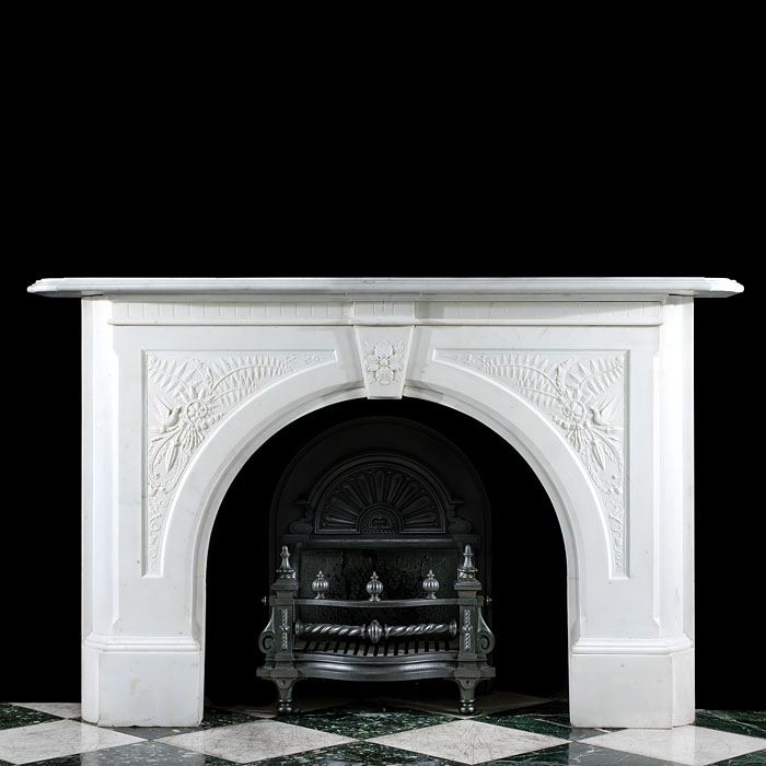 An arched Victorian Statuary Marble fireplace