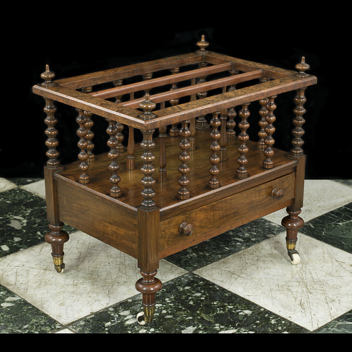 A Victorian walnut single drawer canterbury