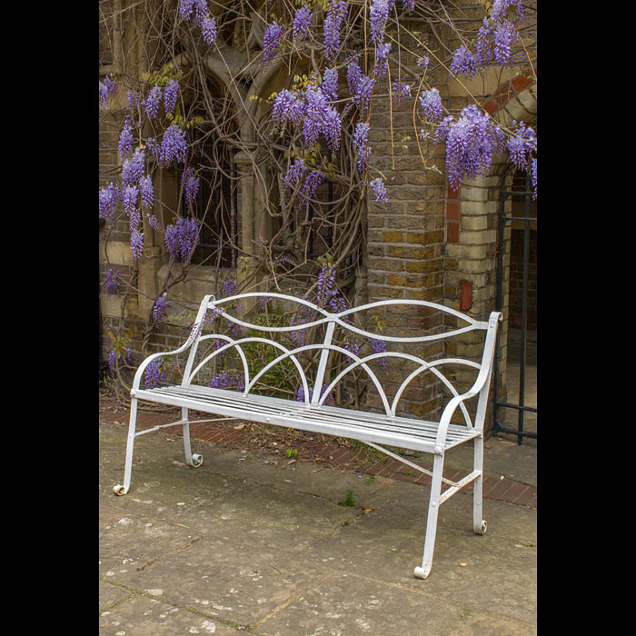 A wrought iron white painted Regency garden seat