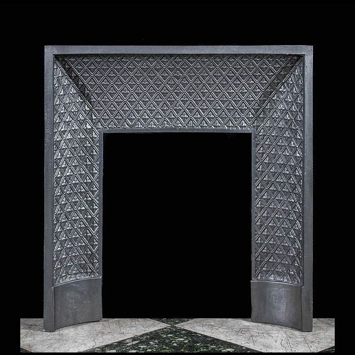 A cast iron Louis XVI fireplace insert