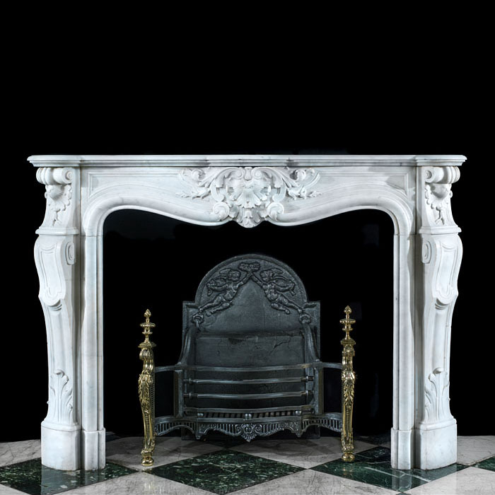 A Louis XV Style Carrara Marble Fireplace