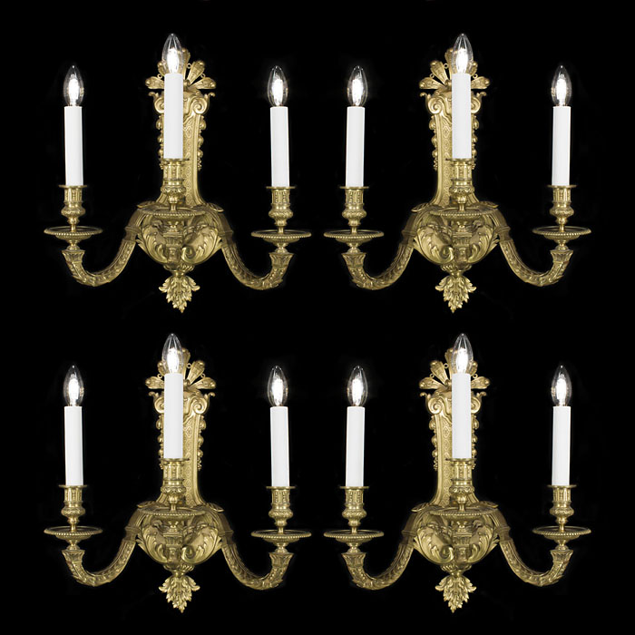 A Regency style set of four brass wall lights