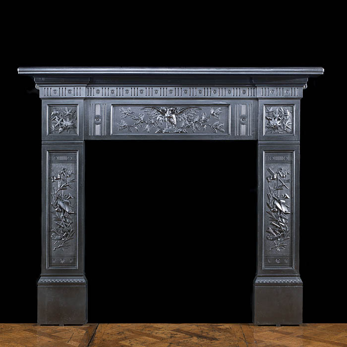 A cast iron Victorian eagle fire surround