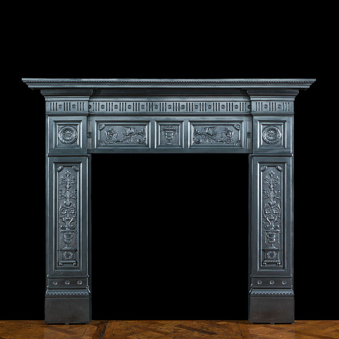 A Victorian cast iron fireplace surround