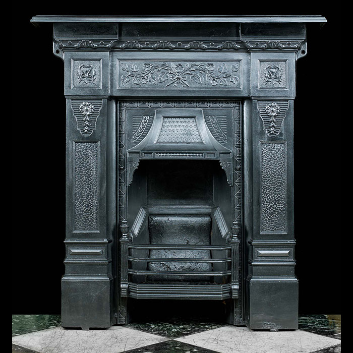 A small Victorian cast iron fire surround
