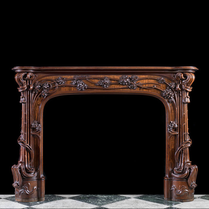 A rare walnut Art Nouveau fire surround