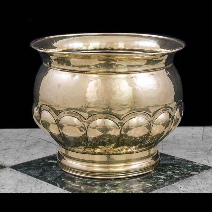 A gadrooned Victorian brass jardiniere