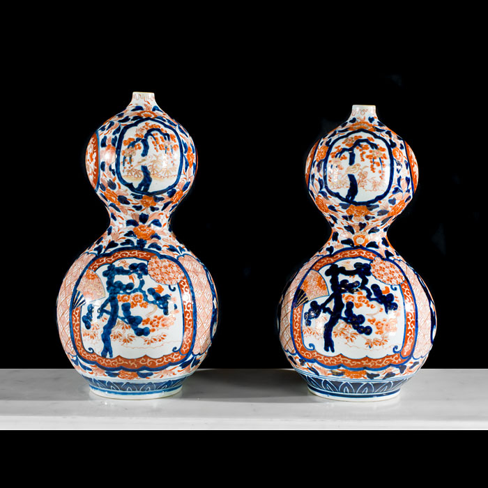 A pair of Meiji Period hand painted vases