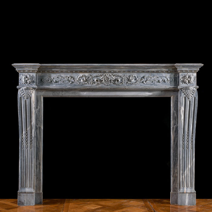 A Louis XVI grey marble chimneypiece