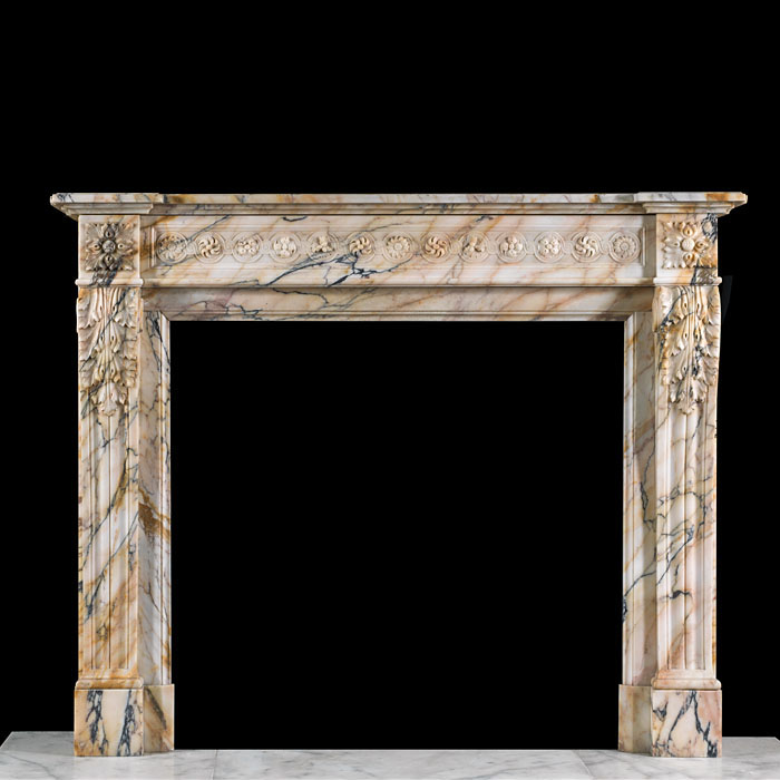 A Pavonazzo Marble chimneypiece
