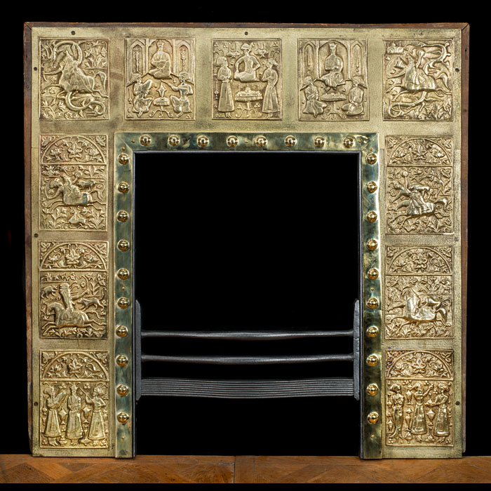 An Edwardian brass fireplace insert