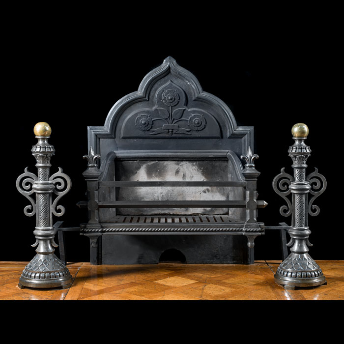 A Gothic Revival cast iron fire grate