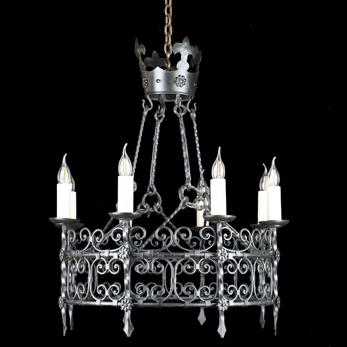 A Tudor Revival style iron chandelier