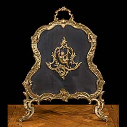 A Rococo style gilt brass fire screen