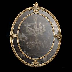 An oval sectional Victorian wall mirror