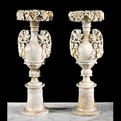A tall pair of alabaster urns
