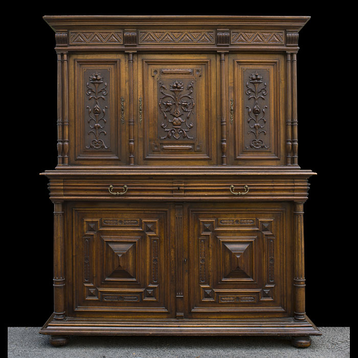 A French antique carved walnut cupboard