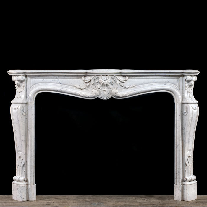 A Louis XV Rococo fireplace surround