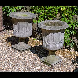 A pair of reconstituted 20th century garden urns