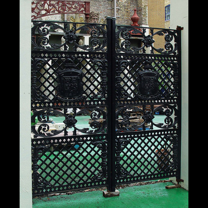 A pair of Victorian antique armorial cast iron gates