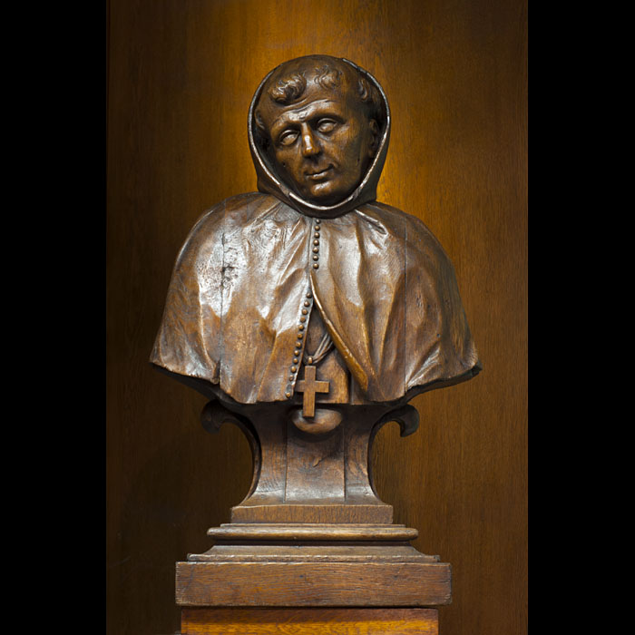 A 19th century carved oak French bust of a Monk