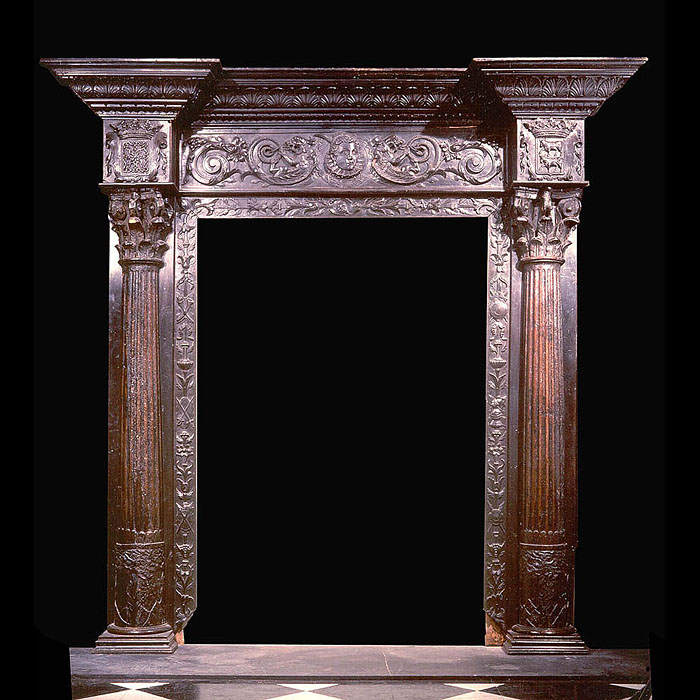 4619:  An imposing carved walnut doorway in the Renaissance manner,the breakfront carved cornice with a frieze centred by a portrait ofa noblewoman flanked by foliate scrolls with armorials, the Corint