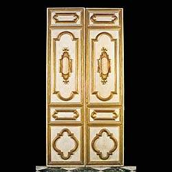 4631:  A pair of giltwood and ivory painted double doors from an Italian palazzo, the moulded giltwood decoration centred by a Jasper panel. The reverse sides are unpanelled at present. Late 17th centu