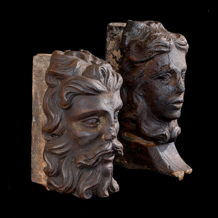 A pair of oak heads of Jacobean nobility