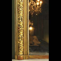 Antique French Gilt Wood Overmantel Mirror in the Louis XV style   This is a French Louis XV style Gilt Wood Overmantel Mirror with floral and shell decoration. 1860.