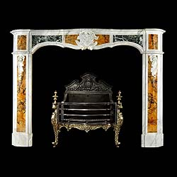 6179: A Louis XV antique fireplace with serpentine frieze and each jamb decorated with inlaid Brocatelle de Sienena and Maurine Green marbles the frieze with a central foliate cartouche & with floral scroll