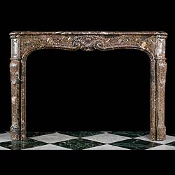 6275: A large Louis XV antique mantel in Breched'Allepe marble, the serpentine shelf over scrolled floral central cartouche, supported on panelled jambs. French circa 1850.    Link to: Antique Rococo Chimne