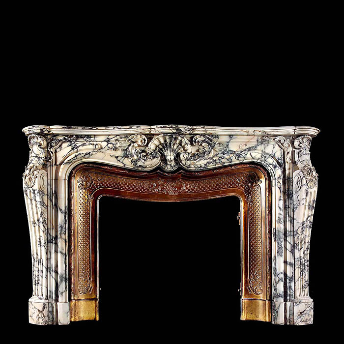 A large antique Rococo Sienna Claire marble fireplace surround