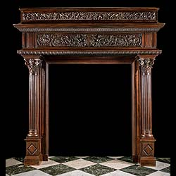 6439: A tall impressive profusely carved walnut chimneypiece in the Renaissance manner. The cornice carved with scrolled carved detail, over carved palmette detail on the middle moulding beneath which the f