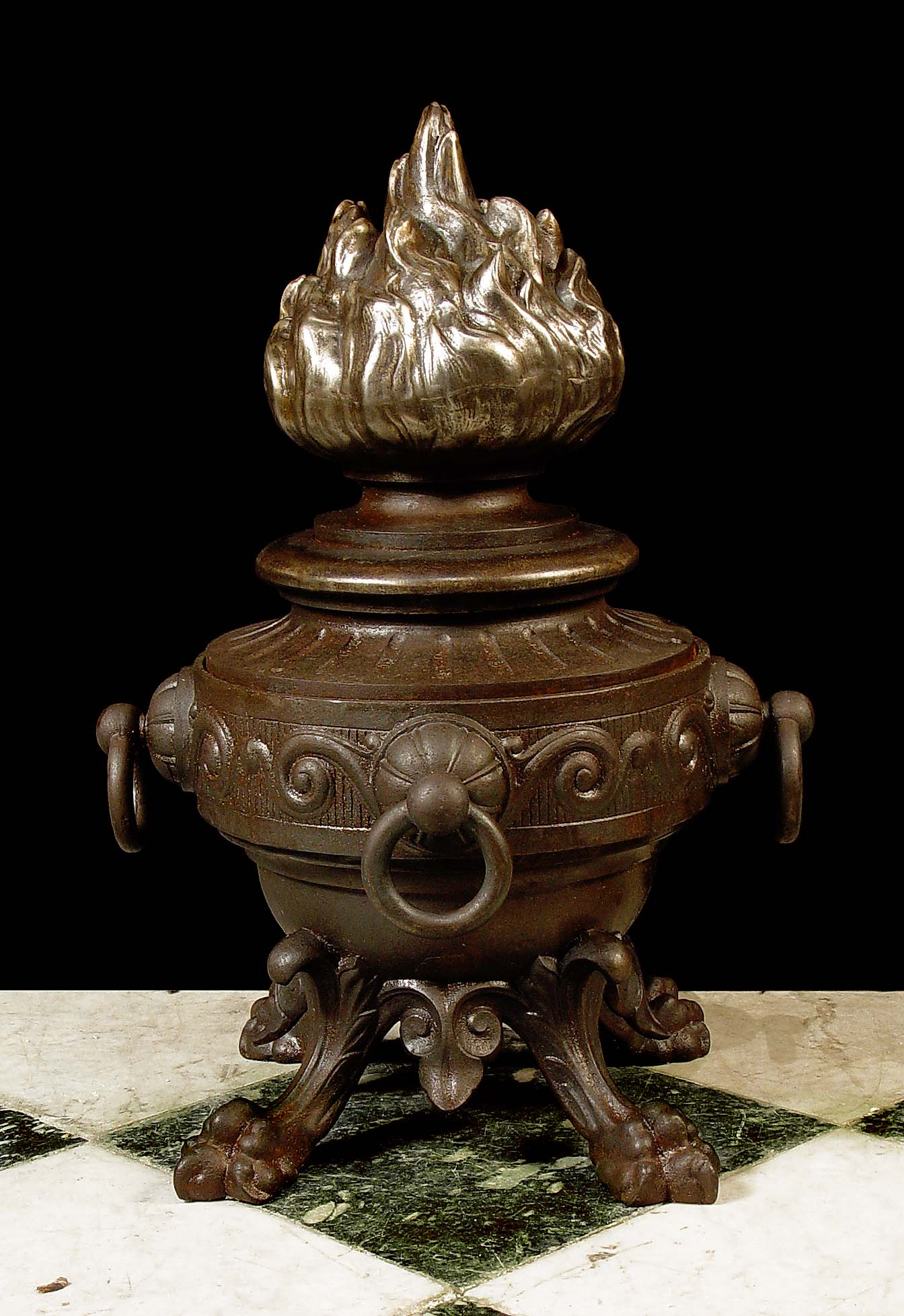 6477: A large cast iron Urn Torchere Finial in the Roman manner with flame top, four rings around the circumference and supported on four lion paw feet. French 19th century.  Link to: Antique sculptures, ca